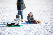 Kids getting pulled on sleds