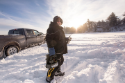 Man ready to go ice fishing with gear