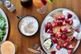 Pancakes with strawberries and coffee served at The Nucleus