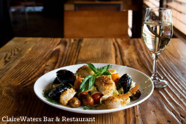 Plated dish and wine at ClaireWaters Bar & Restaurant