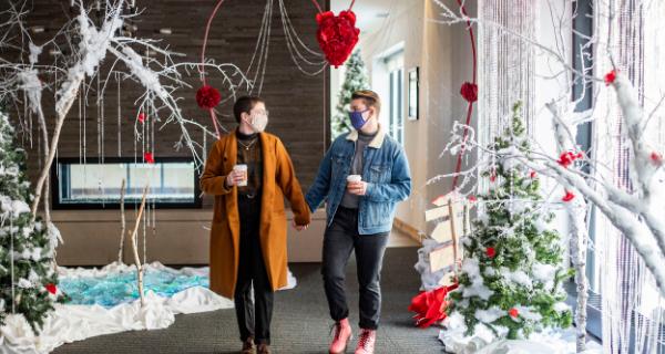 Couple walking through Winter Wonderland display at the Lismore Hotel