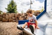 Child on slide at River Prairie