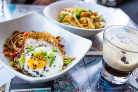 Noodle dishes and coffee cocktail served at restaurant in Rockford, IL
